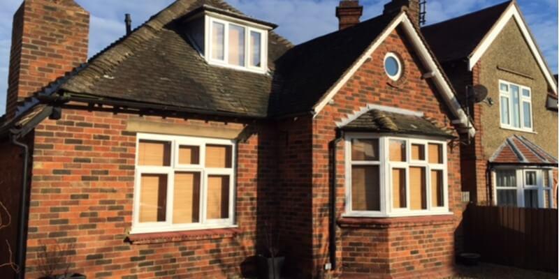 brick house with white windows